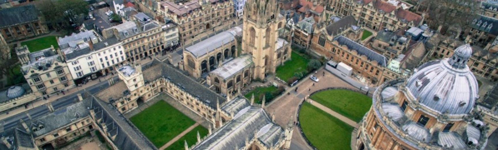 Aerial view of Oxford depicting colleges and green lawns