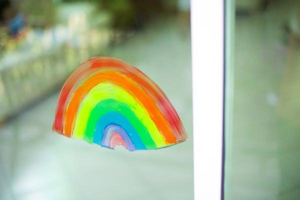 painted rainbow on window pane