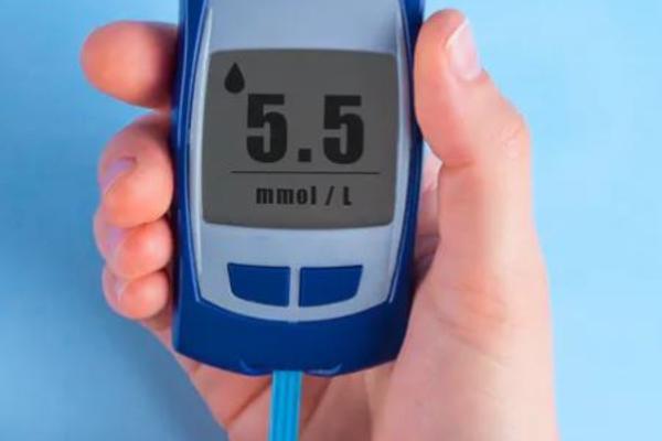 blood sugar test kit in action on finger