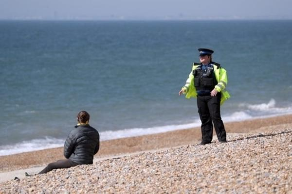 A change in responsibility. Andrew Matthews/PA. Policeman on beach