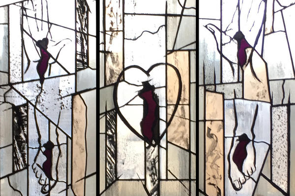 The North Window of Nuffield College's Chapel depicts the Five Wounds of Christ, with the feet, hands and heart isolated, drawn in outline with the only colour being the gashes of blood.
