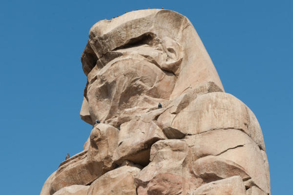 Photo of the Colossus of Memnon from the bottom right looking up