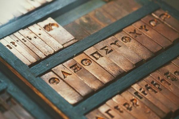 Collection of old printing press type in wooden box