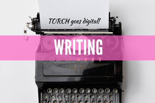 Black typewriter, words read TORCH Goes Digital, Writing