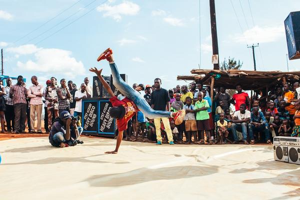 colourful image of a man breakdancing in Uganda