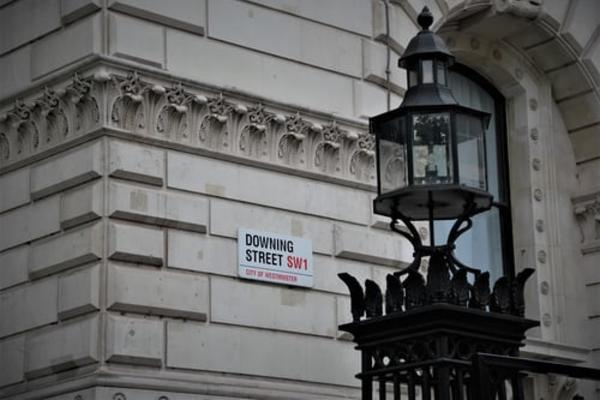 Image of Downing Street sign on brick building