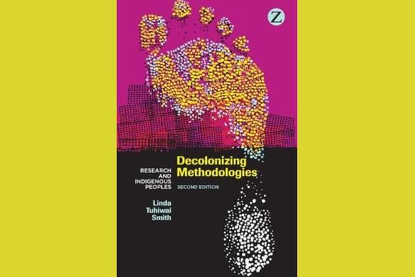 book cover with styalised foot against yellow background