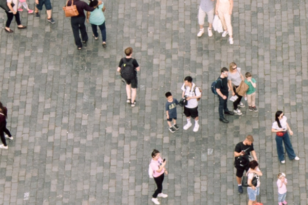 aerial shot of people walking on a paved area