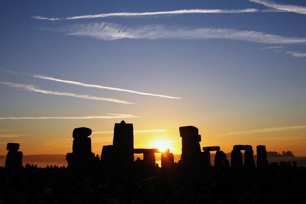 summer solstice sunrise over stonehenge