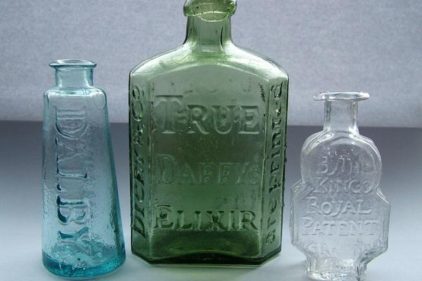 1280px three early medicine bottles