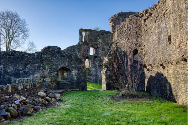 Image of the interior of the ruined Great Hall at Abergavenny Castle, looking west.