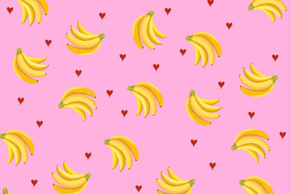 Bunches of yellow bananas with pink background