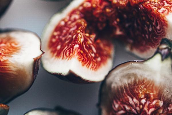 Close up of red and white cut figs