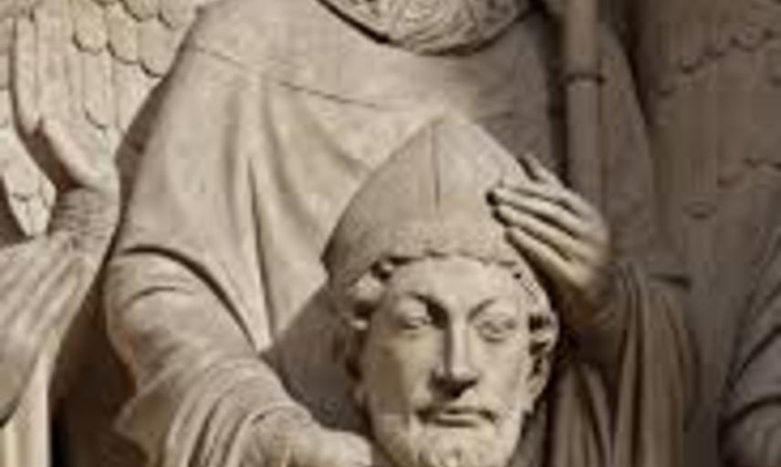 Architectural scultpure showing saiting holding his hat
