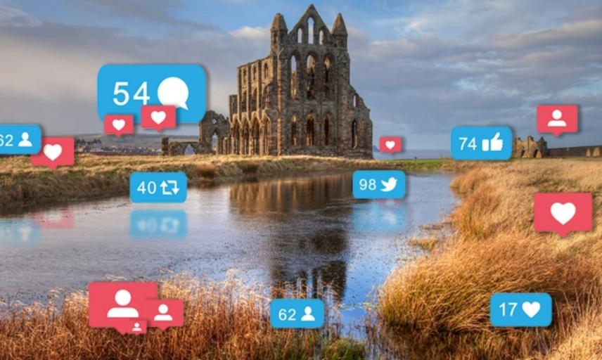 Photo of a monument overlaid with social media reaction buttons