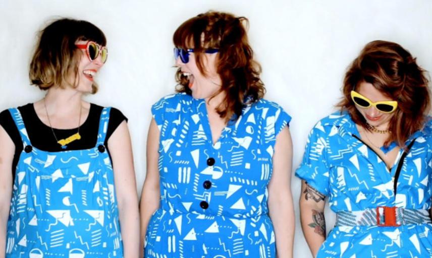 Three women in blue tunics