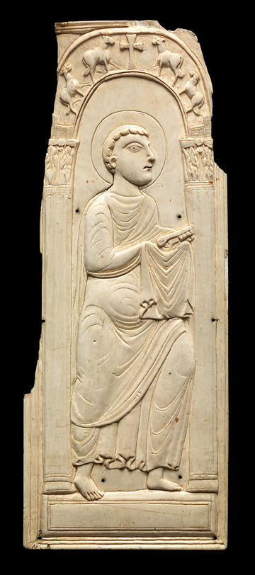 marble relief scultpure of a man sitting holding a cloth