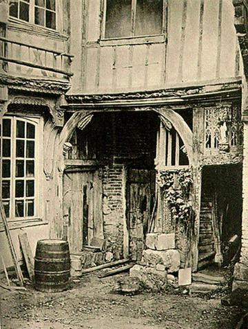 A Courtyard at Abbeville photographed by John Ruskin in 1858, image depicting an archway entrance