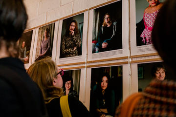 Close up of a member of the public looking at the 100 Women of Oxford exhibition