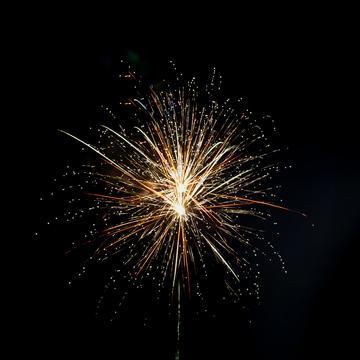 Large firework against black sky
