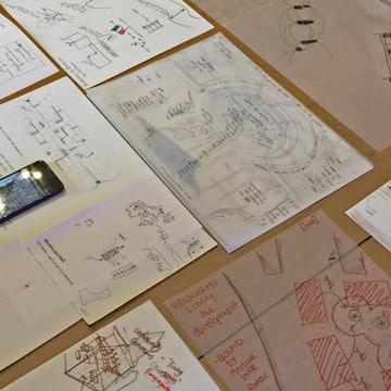 Display of sketches of scores created during the Scoring Belfast Workshop