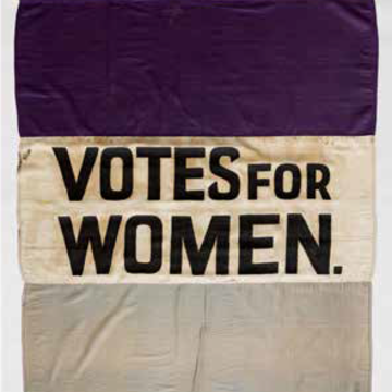 Women's Suffrage flag, purple, white, and grey stripes with the inscrription of 'Votes for Women' on the white stripe.