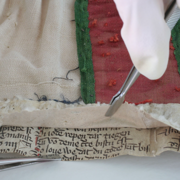 Forcepts used to peel back material from manuscript
