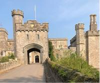 The facade of Powderham Castle with its gateway and turrets