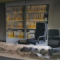 Charred chair and desk following arson attack