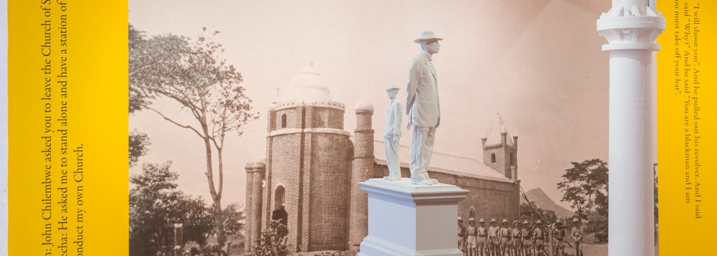 Image depicts the cast of two statues of different height on a plinth